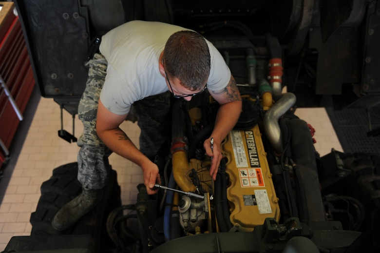 U.S. Air Force Staff Sgt. Shayne Kusserow, a 606th Air Control Squadron vehicle maintenance journeyman from Las Cruces, N.M., reinstalls a fuel water separator July 30, 2014, at his squadron at Spangdahlem Air Base, Germany.  A fuel water separator removes water condensation from the fuel. (U.S. Air Force photo by Airman 1st Class Dylan Nuckolls/Released)