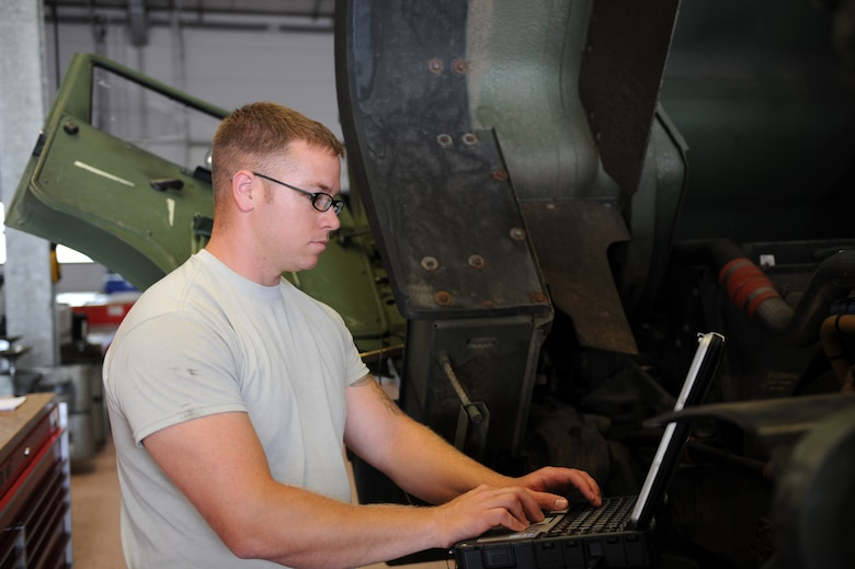 U.S. Air Force Staff Sgt. Shayne Kusserow, a 606th Air Control Squadron vehicle maintenance journeyman from Las Cruces, N.M., troubleshoots on a five-ton truck July 30, 2014, at his squadron at Spangdahlem Air Base, Germany. The vehicle maintenance shop maintains 173 vehicles, including humvees and five-ton trucks, assigned to the 606th ACS. (U.S. Air Force photo by Airman 1st Class Dylan Nuckolls/Released)