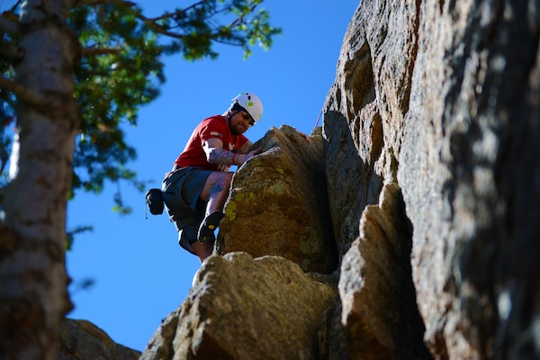 Army veteran Ben Kaufman scales the face of a cliff during a USO-sponsored rock-climbing camp at Estes Park, Colo., Aug. 2, 2014.  DoD photo by Army Sgt. 1st Class Tyrone C. Marshall Jr.