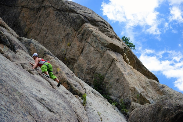 "Army veteran Jill Glasenapp scales the face of a cliff site known as ""The Pear"" using a top-roping technique during a rock-climbing camp at Estes Park, Colo., Aug. 3, 2014.  DoD photo by Army Sgt. 1st Class Tyrone C. Marshall Jr."