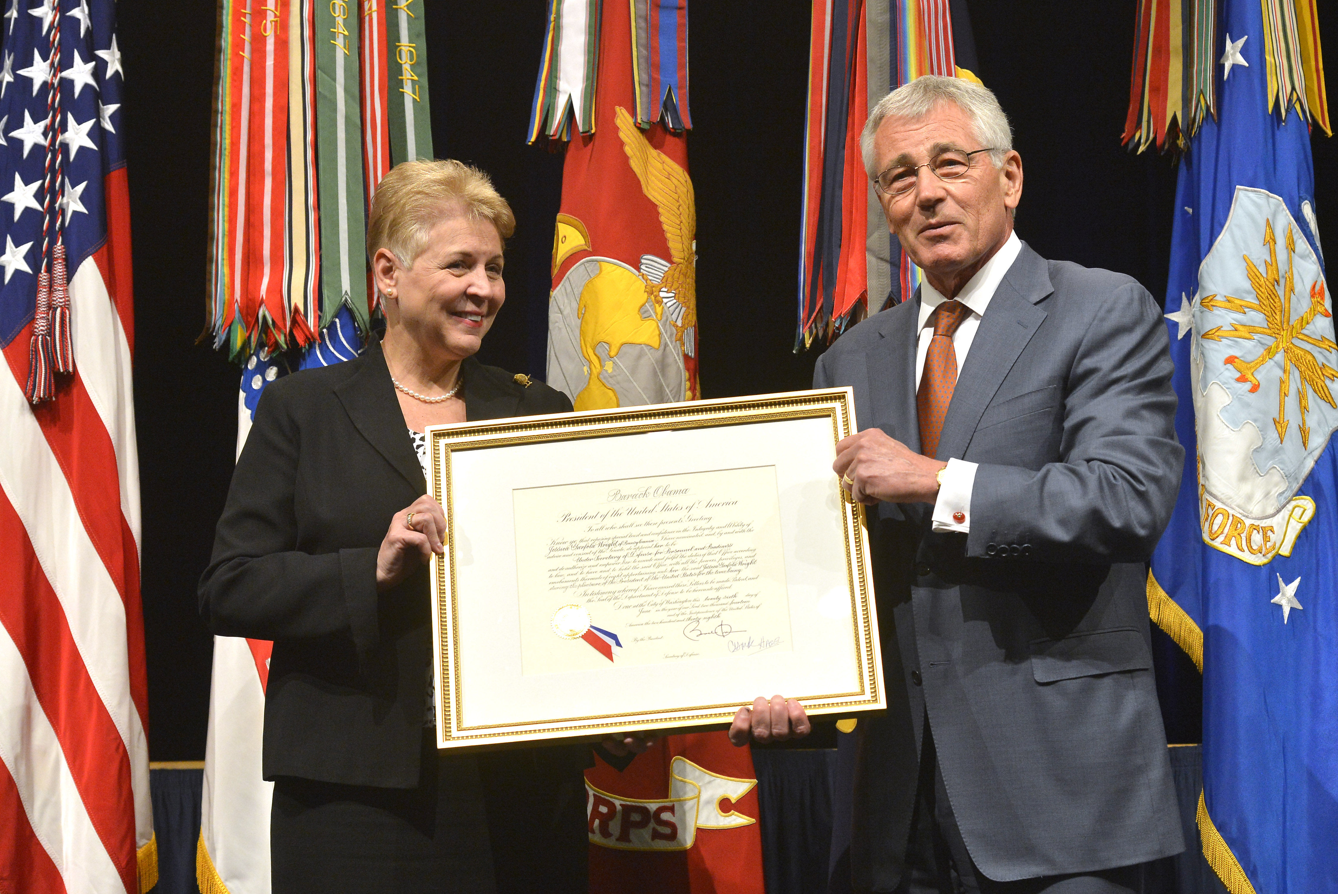 Defense Secretary Chuck Hagel Presents Jessica L Wright Undersecretary Of Defense For Personnel And Readiness With