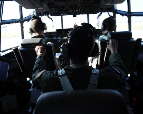 Air Force pilots prepare for takeoff in a C-130J Super Hercules July 23, 2014, at Dyess Air Force Base, Texas. Two 317th Airlift Group C-130Js successfully employed air-to-air tactics against an F-16 Fighting Falcon during a training exercise en route to Naval Air Station Joint Reserve Base Fort Worth, Texas. (U.S. Air Force photo by Airman 1st Class Kedesha Pennant)