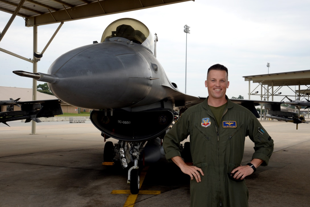 Marine Corps Maj. Eric Hugg stands next to an F-16CJ Fighting Falcon July 31, 2014, at Shaw Air Force Base, S.C. Hugg is a trained A/V-8B II Harrier pilot in the Marine Corps assigned to Shaw AFB's 55th Fighter Squadron as an F-16 pilot as part of an exchange program. (U.S. Air Force photo/Airman 1st Class Jonathan Bass)