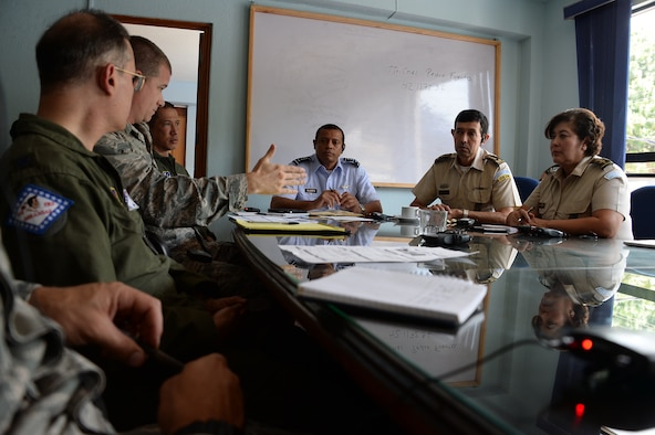 Members from the Guatemalan air force, Arkansas Air National Guard, and 12th Air Force (Air Forces Southern) discuss their goals during a subject matter expert exchange Aug. 4, 2014, in Guatemala City, Guatemala. Goals focused on educating the Guatemalan air force on individual readiness and establishing standards for flight medicine. (U.S. Air Force photo/Tech. Sgt. Heather R. Redman)