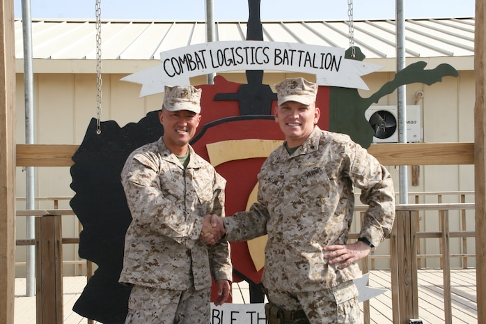 Lt. Col. Joon H. Um, left, commanding officer, Combat Logistics Battalion 1, shakes hands with Lt. Col. Sid R. Welch, commanding officer, CLB-7, after a transfer of authority ceremony held aboard Camp Leatherneck, Helmand province, Afghanistan, Aug. 1, 2014. Combat Logistics Battalion 1 replaced CLB-7 as the last unit to aid Regional Command (Southwest) with tactical-level logistical support and will close out another chapter in Marine Corps history as the last unit to serve as the logistics combat element for RC(SW).