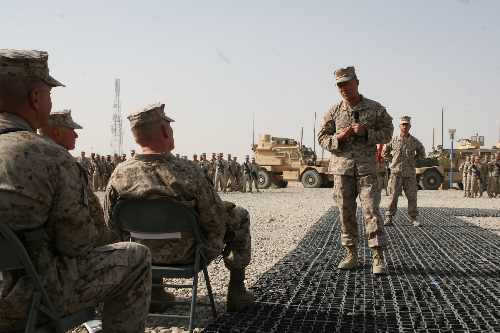 Lt. Col. Joon H. Um, right, commanding officer, Combat Logistics Battalion 1, addresses guests during a transfer of authority ceremony held aboard Camp Leatherneck, Helmand province, Afghanistan, Aug. 1, 2014. Combat Logistics Battalion 1 replaced CLB-7 as the last unit to aid Regional Command (Southwest) with tactical-level logistical support and will close out another chapter in Marine Corps history as the last unit to serve as the logistics combat element for RC(SW).