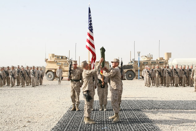 Lt. Col. Joon H. Um, right, commanding officer, Combat Logistics Battalion 1, and Sgt. Maj. Mark W. Upp, sergeant major, CLB-1, uncase the unit's battle colors during a transfer of authority ceremony held aboard Camp Leatherneck, Helmand province, Afghanistan, Aug. 1, 2014. Combat Logistics Battalion 1 replaced CLB-7 as the last unit to aid Regional Command (Southwest) with tactical-level logistical support and will close out another chapter in Marine Corps history as the last unit to serve as the logistics combat element for RC(SW).