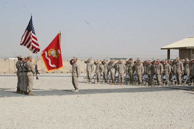 Marines and sailors with Regional Command (Southwest) salute in formation as the national anthem is played during a transfer of authority ceremony held for Combat Logistics Battalion 7 and CLB-1 aboard Camp Leatherneck, Helmand province, Afghanistan, Aug. 1, 2014. Combat Logistics Battalion 7 was replaced by CLB-1 as the last unit to aid RC(SW) with tactical-level logistical support. Combat Logistics Battalion 1 will close out another chapter in Marine Corps history as the last unit to serve as the logistics combat element for RC(SW).