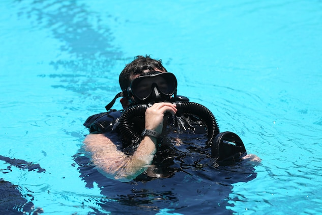 A Special Amphibious Reconnaissance Corpsman surfaces after a 10 minute dive during proficiency dive training aboard Camp Pendleton, Calif., July 22. The SARCs were supported by Navy Divers from 1st Reconstruction consolidated dive locker.