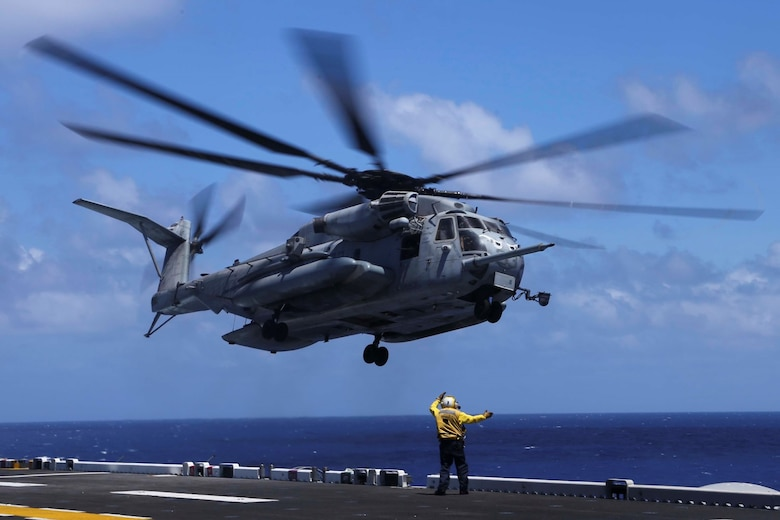 A CH-53E Super Stallion with Marine Medium Tiltrotor Squadron 163 (Reinforced), 11th Marine Expeditionary Unit, takes off from the flight deck of the USS Makin Island, Aug. 1, 2014.  The 11th MEU and Makin Island Amphibious Ready Group are deployed as a sea-based, expeditionary crisis response force capable of conducting amphibious missions across the full range of military operations.