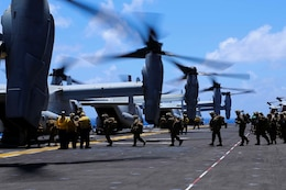 Marines with Golf Company, Battalion Landing Team 2nd Battalion, 1st Marines, 11th Marine Expeditionary Unit, load onto MV-22B Ospreys with Marine Medium Tiltrotor Squadron 163 (Reinforced), 11th MEU, for training Marine Corps Training Area Bellows, Hawaii Aug 1..  The 11th MEU and Makin Island Amphibious Ready Group are deployed as a sea-based, expeditionary crisis response force capable of conducting amphibious missions across the full range of military operations.  (U.S. Marine Corps photo by Lance Cpl. Laura Y. Raga/Released)