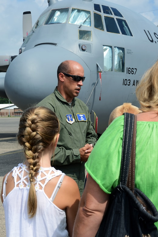 Master Sgt. Elcian Torres, loadmaster with the 118th Airlift Squadron, talks to a very interested crowd of Cub Scouts, parents and siblings during a tour of the a C-130H Hercules aircraft recently assigned to the 103rd Airlift Wing, at Bradley Air National Guard Base, East Granby, Conn., Aug. 4, 2014. In the forefront is Addison Duquette, 11, and her mother Jodi Stupakevich. (U.S. Air National Guard photo by Tech. Sgt. Joshua Mead/Released)