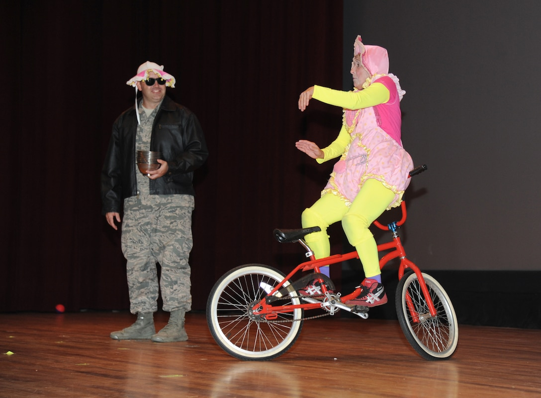 Master Sgt. Robert Kesler, 81st Force Support Squadron, assists a Saltoriya performer, who portrays a wandering baby, during a military appreciation show Aug. 1, 2014, at the Welch Theater, Keesler Air Force Base, Miss.  Saltoriya features some of the best international aerialists and artists who perform gravity-defying feats. (U.S. Air Force photo by Kemberly Groue)