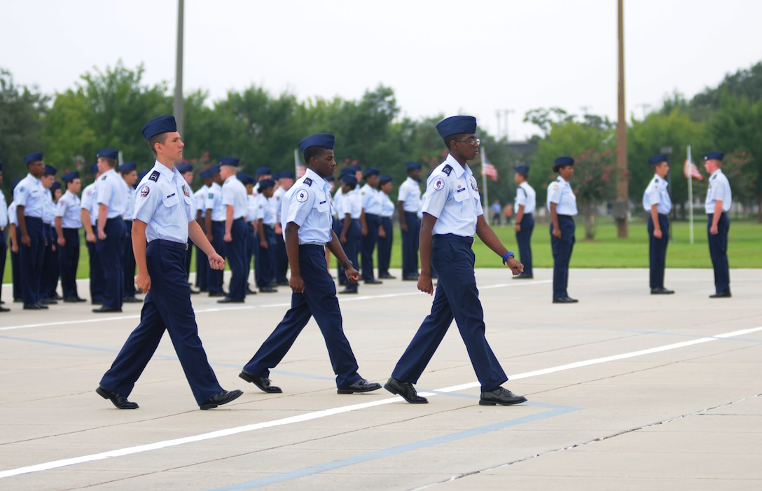 JROTC cadets prepare to march in review during a student parade Aug. 1, 2014, at the Levitow Training Support Facility, Keesler Air Force Base, Miss.  Approximately 100 JROTC students from seven states attended a week-long JROTC Summer Leadership School at Keesler that ended with the parade and a graduation ceremony at the Welch Theater.  (U.S. Air Force photo by Kemberly Groue)