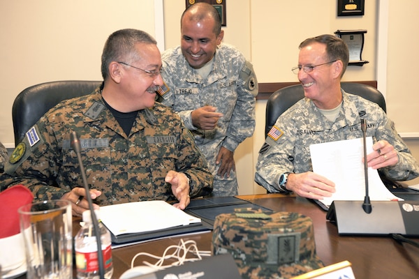 Brig. Gen. Armando Mejia (left), the Salvadoran army commander and head of the Salvadoran delegation, shares a laugh with Maj. Gen. Joseph P. Disalvo (right), the U.S. Army South commanding general and head of the U.S. delegation, while Maj. Sergio Trejo (center), the Army South Central American desk officer, translates during the U.S. Army South/Salvadoran Army-to-army staff talks July 15 at the Army South headquarters on Joint Base San Antonio-Fort Sam Houston  Photo by Eric Lucero