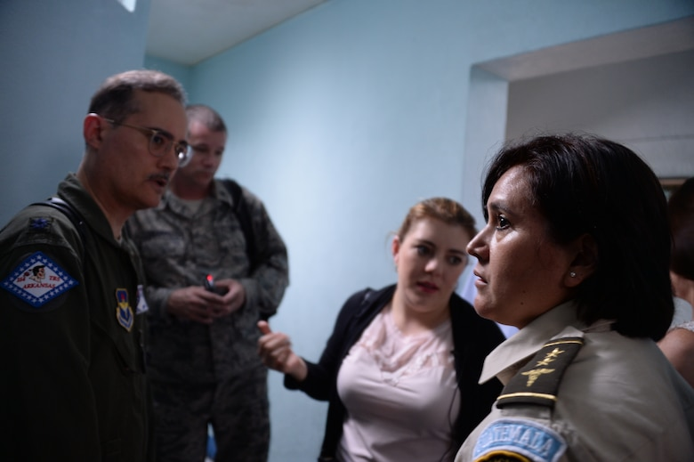 Col. Veronica Dono, nurse with the Guatemalan air force gives a tour of the hospital to members of Arkansas Air National Guard, and 12th Air Force (Air Forces Southern) during a subject matter expert exchange in Guatemala City, Guatemala, Aug. 4, 2014.  The visiting members wanted to look at the facilities to better understand the needs of the Guatemalan air force.  (U.S. Air Force photo by Tech. Sgt. Heather R. Redman/Released)