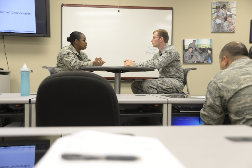Senior Airman Sachel Barber, left, 42nd Communications Squadron, and Senior Airman Joshua Goodpaster, Air Force Life Cycle Management Flight, go over scenarios that could go come up in a feedback session using the new Airman Comprehensive Assessment form Aug. 1, 2014, at the Maxwell Professional Development Center. The center is hosting briefings and classes to help Airmen familiarize with the new form. (U.S. Air Force photo by Staff Sgt. Natasha Stannard)