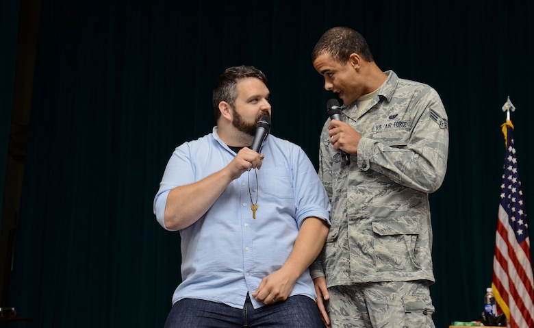 "Senior Airman Michael Summers, 644th Combat Communications Squadron, tries to persuade Colin Sweeney, ""A Shot of Reality With a Comedy Chaser"" cast member, not to drink and drive after a party. Joint Region Marianas sponsored the comedy show designed to educate Airmen and Sailors on the dangers and responsibilities that come with drinking alcohol. (U.S. Air Force photo by Staff Sgt. Robert Hicks/Released)"