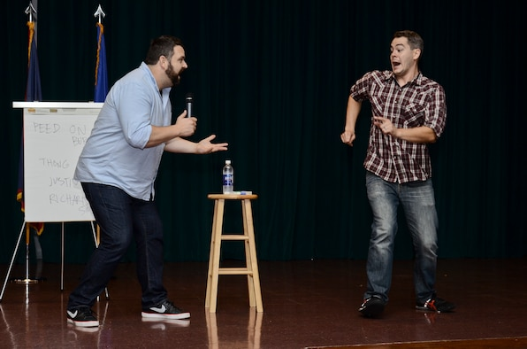 "Bryce Wissel (right), acts out a scene from a drunk party to Colin Sweeney (left), both ""A Shot of Reality With a Comedy Chaser"" cast members, July 31, 2014, on Andersen Air Force Base, Guam.  Joint Region Marianas sponsored the comedy show designed to educate Airmen and Sailors on the dangers and responsibilities that come with drinking alcohol. (U.S. Air Force photo by Staff Sgt. Robert Hicks/Released)"