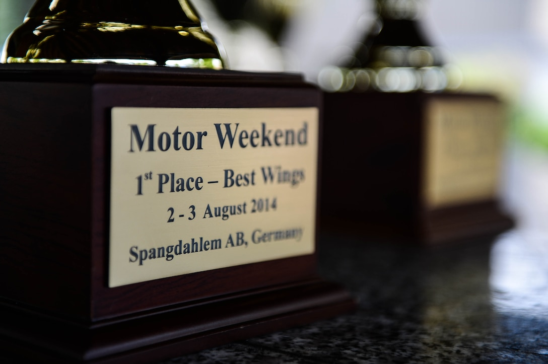 A first-place place trophy is displayed in the Motor Weekend car show at Spangdahlem Air Base, Germany, Aug. 2, 2014. U.S. Air Force Master Sgt. Martin Lerch, barbeque contestant and Riverside, Calif., native, was the first place winner for having the best barbeque wings and ribs. (U.S. Air Force photo by Airman 1st Class Kyle Gese/Released)