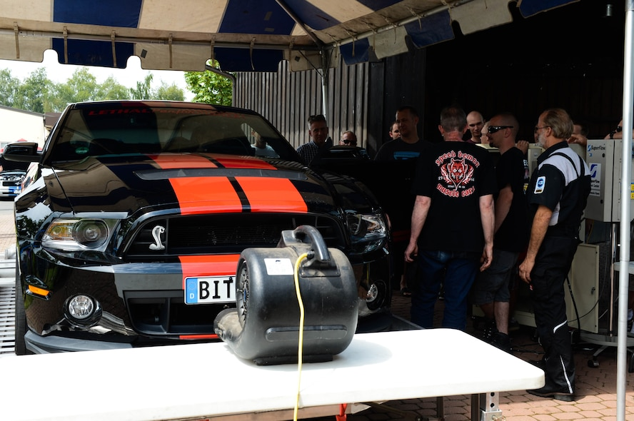 Judges run tests on U.S. Air Force Staff Sgt. Josh Hoke's car, a Motor Weekend competitor and Whitney, Texas native, at Spangdahlem Air Base, Germany, Aug. 2, 2014. The judges measured the output of the 2012 Ford Shelby GT-500 rear-wheel horsepower. The owner with the highest output received a trophy. (U.S. Air Force photo by Airman 1st Class Kyle Gese/Released)