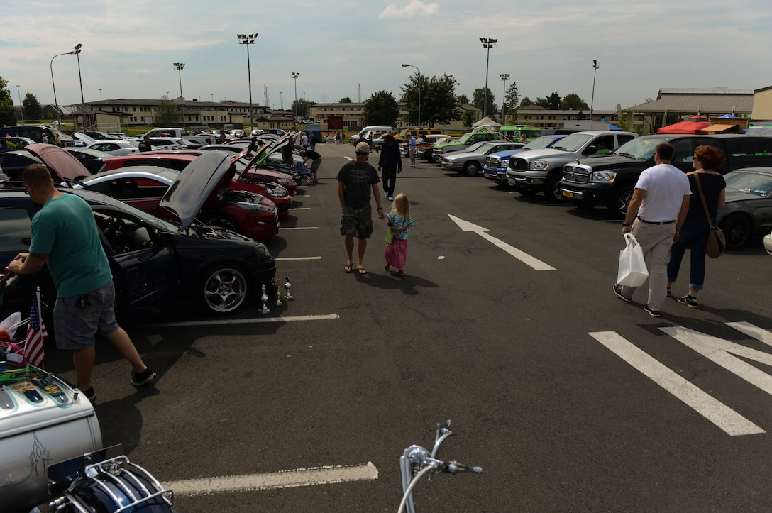 People display their vehicles in the Motor Weekend car show at Spangdahlem Air Base, Germany, Aug. 2, 2014. The 52nd Force Support Squadron sponsored the car show, and more than 180 people registered their vehicles. (U.S. Air Force photo by Airman 1st Class Kyle Gese/Released)