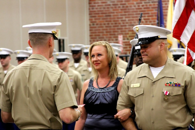 U.S. Marine Corps Gunnery Sgt. Marvin Faulcon, right, receives the Meritorious Service Medal during his retirement ceremony after 21 years of service to the Marine Corps, at Recruiting Station Richmond in Richmond Virginia, July 25, 2014. Next to him, his wife of 20 years, Connie, was recognized by RS Richmond's Commanding Officer, Maj. Ryan Gordinier, for her outstanding support to her husband and the Corps. Faulcon, a native of Frankfurt, Germany, was a career recruiter and served as RS Richmond's assistant recruiter instructor. The couple and their two daughters will relocate to Austin, Texas, where Faulcon will pursue a second career in Human Resources. (U.S. Marine Corps photo by Cpl. Aaron Diamant/Released)