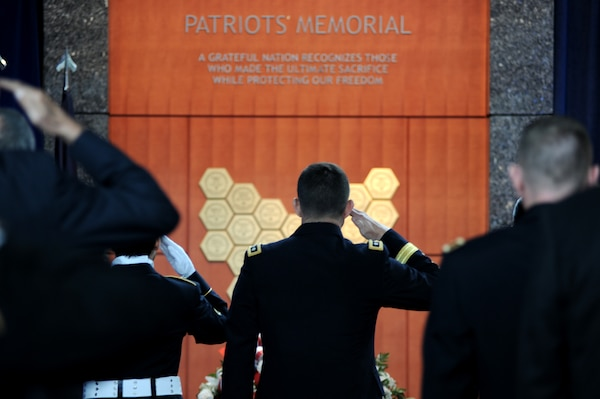 Lt. Gen. Michael Flynn salutes DIA's fallen during a 2013 observance ceremony at DIA's Patriots Memorial.