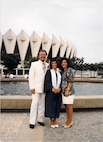 Master Sgt. Liesbeth Bowen (center) stands with her father, Roberto Henriquez, and mother, Liliana Henriquez, while celebrating her college graduation at the Hampton Coliseum in Hampton, Va. Bowen,the  633rd Wing Staff Agency first sergeant, graduated in 1995. (Courtesy photo)