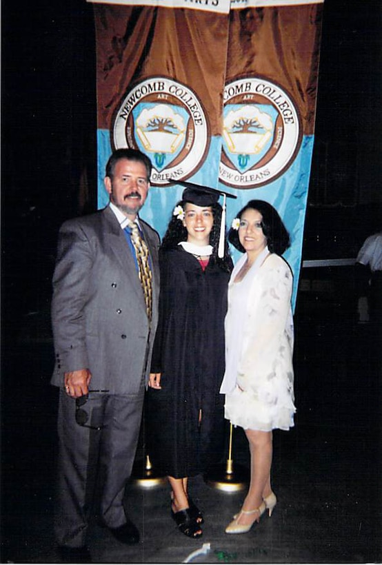 Maj. Liliana Henriquez (center) stands with her father, Roberto Henriquez, and mother, Liliana Henriquez, after graduating from Newcomb College in New Orleans. Maj. Henriquez, Oceana Dam Neck Annex Joint Targeting School joint staff J7 instructor, graduated in 1998. (Courtesy photo)