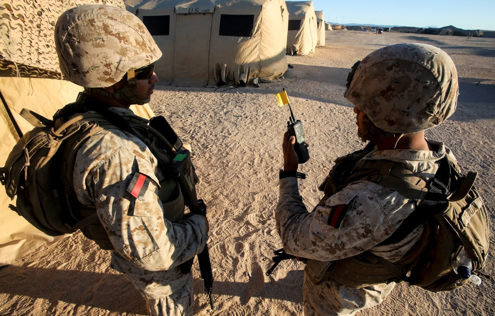 Lance Cpl. Luis Martinez, left, from Jacksonville, Fla., and Lance Cpl. Emilio Tetuan from Topeka, Kan., both with 1st Law Enforcement Battalion, Brigade Headquarters Group, 1st Marine Expeditionary Brigade and tasked to provide security for Camp Francis as Guardian Angels during Large Scale Exercise 2014, perform a radio functionality check aboard Marine Corps Air Ground Combat Center Twentynine Palms, Calif., Aug. 5. LSE-14 is a bilateral training exercise being conducted by 1st MEB to build U.S. and Canadian forces' joint capabilities through live, simulated, and constructive military training activities from Aug. 8-14. (U.S. Marine Corps photo by Cpl. Rick Hurtado/Released)