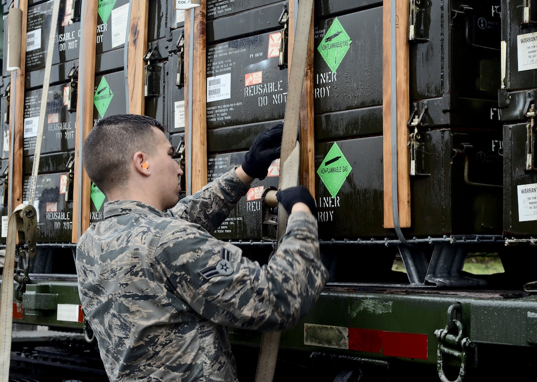 Airman 1st Class Jack Mowery, 36th Munitions Squadron Material Flight storage crew member, straps down a pallet of guidance controlled units July 30, 2014, on Andersen Air Force Base, Guam. The 36th MUNS is home to the largest munition stock pile in the world, valued at $1.3 billion, the material flight also ensures proper storage practices are utilized, inspect and maintain the munitions and ensure accountability of over 9 million individual items. (U.S. Air Force photo by Staff Sgt. Robert Hicks/Released)