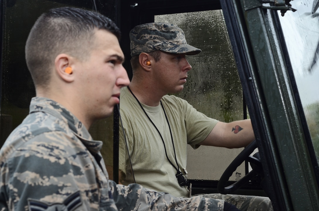 Senior Airman Brian Fish (left), listens to Airman 1st Class Jack Mowery (right), both 36th Munitions Squadron Material Flight storage crew members, as he explains where to drop a pallet of guidance controlled units July 30, 2014, on Andersen Air Force Base, Guam. The 36th MUNS is home to the largest munition stock pile in the world, valued at $1.3 billion, the material flight also ensures proper storage practices are utilized, inspect and maintain the munitions and ensure accountability of over 9 million individual items. (U.S. Air Force photo by Staff Sgt. Robert Hicks/Released)