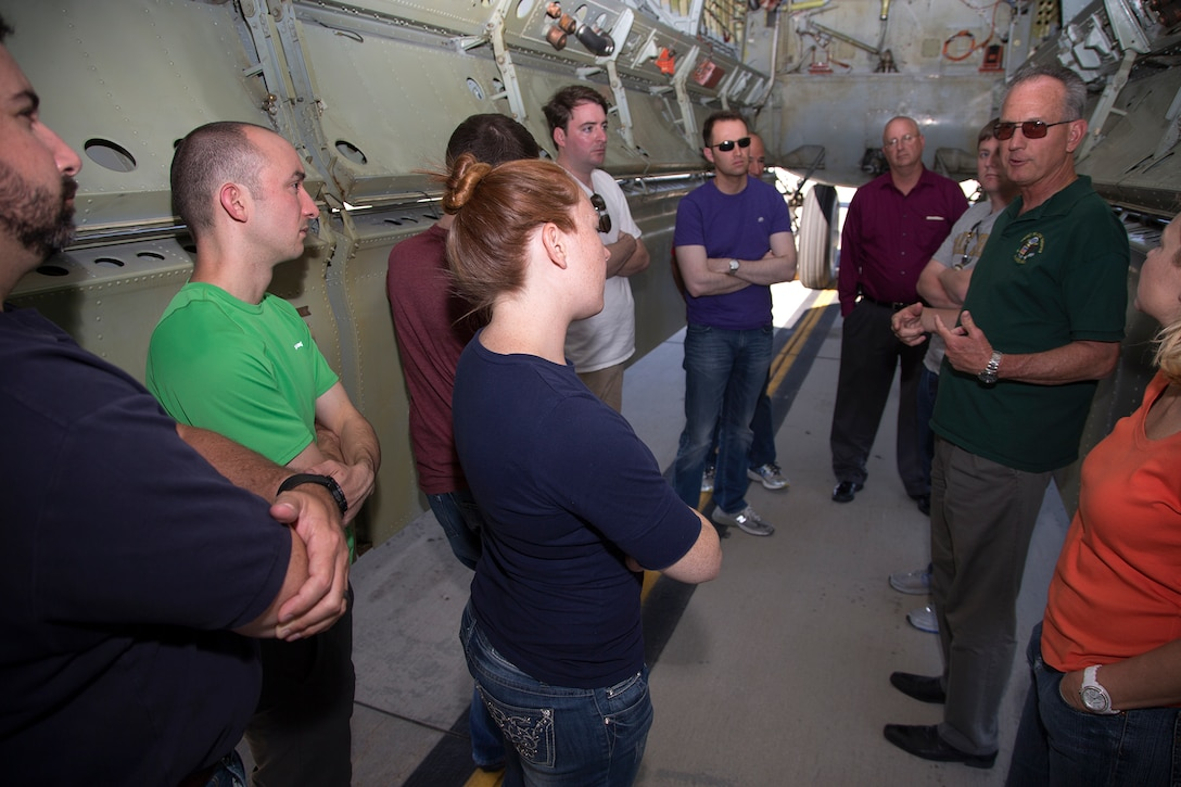 Dr. David Smith, 412th Test Wing Installation Support director (right), speaks to congressional staffers inside the bomb bay of a B-52 bomber. This was the last part of the tour before departing Edwards Aug. 5 following their two-day visit. (U.S. Air Force photo by Christian Turner)