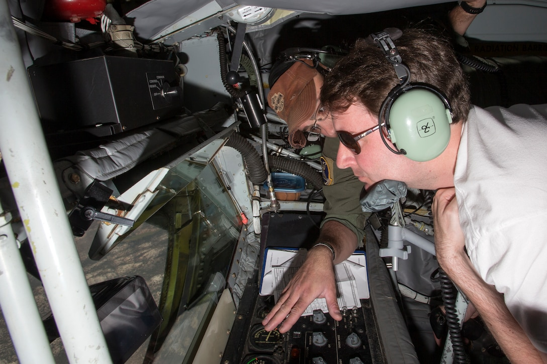 """The staffers began the second day of their visit, Aug. 5, by participating in a pre-flight brief at Test Operations in preparation for a flight aboard a KC-135 Stratotanker. During the test flight, the KC-135, known as """"The Mighty War Wagon,"""" extended its flying boom to refuel an F-15 and an F-16 in flight. The Stratotanker is capable of pumping nearly all of its internal fuel through the flying boom, its primary fuel transfer method. Each staffer was given the chance to lie in the boom pod where the boom operator controls the boom. (U.S. Air Force photo by Christian Turner)"""