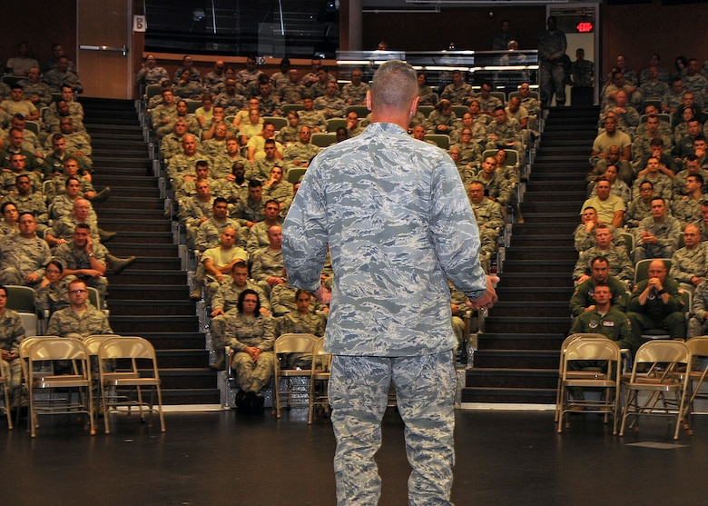 Colonel Arthur Floru, 143d Airlift Wing Commander, addresses the members of the 143d AW during the Rhode Island Air National Guard's annual Wingman Day on 3 August 2014. The event was held at the Knight Campus of the Community College of Rhode Island in Warwick, RI. National Guard Photo by Technical Sgt Jason Long (RELEASED)