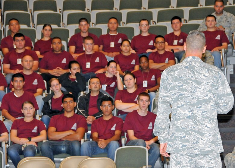 Colonel Arthur Floru, 143d Airlift Wing Commander, turns to address the members of the 143d AW Student Flight during the Rhode Island Air National Guard's annual Wingman Day on 3 August 2014. The event was held at the Knight Campus of the Community College of Rhode Island in Warwick, RI. National Guard Photo by Technical Sgt Jason Long (RELEASED)