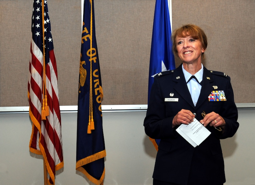 Newly promoted Col. Donna Prigmore addresses the Airmen and others in attendance for the 142nd Mission Support Group Change of Command ceremony, Portland Air National Guard Base, Ore., Aug. 3, 2014. (U.S. Air National Guard photo by Tech. Sgt. John Hughel, 142nd Fighter Wing Public Affairs/Released)