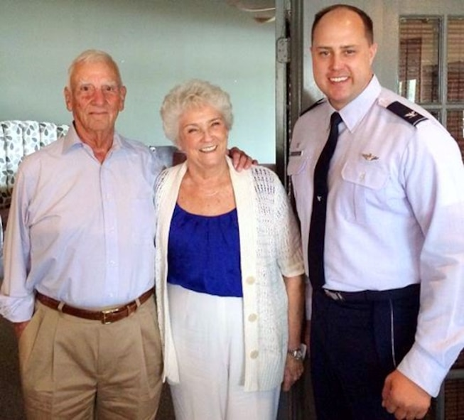 "(Ret.) Col. Carlyle ""Smitty"" Harris, his wife Louise, and Col. John Nichols, 14th Flying Training Wing Commander, pause for a photo at South restaurant in Tupelo, Mississippi Aug. 4.  Harris was one of the original creators of the TAP code, which was used to communicate to the other prisoners in the solitary confinement."