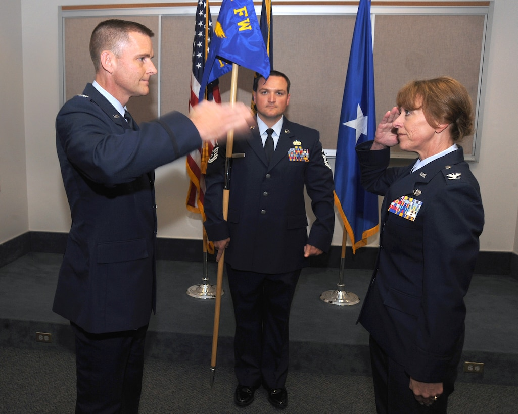 Col. Rick Wedan, 142nd Fighter Wing Commander, left, returns the salute form the new 142nd MSG Commander Col. Donna Prigmore, right, during the Mission Support Group Change of Command Ceremony, Portland Air National Guard Base, Ore., Aug. 3, 2014. (U.S. Air National Guard photo by Tech. Sgt. John Hughel, 142nd Fighter Wing Public Affairs/Released)