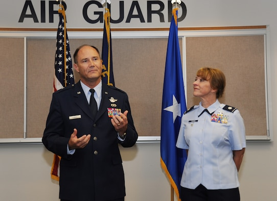Brig. Gen. Michael Stencel, Commander of the Oregon Air National Guard, left, address those in attendance to the promotion and Lt. Col. Donna Prigmore, right, and the Change of Command ceremony for the 142nd Fighter Wing Mission Support Group held at the Portland Air National Guard Base, Ore., Aug. 3, 2014. (U.S. Air National Guard photo by Tech. Sgt. John Hughel, 142nd Fighter Wing Public Affairs/Released)