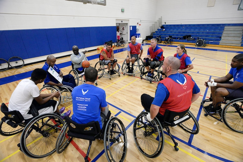 Wounded warriors gather around to learn a play during the final Warrior Games training camp at the Academy Aug. 5. More than 60 wounded veterans from across the country participated in the final Warrior and Invictus Games training camp here Aug. 3-7 to prepare for the fall games, motivate others and take a healthy step toward recovery. (U.S. Air Force photo/Mike Kaplan)