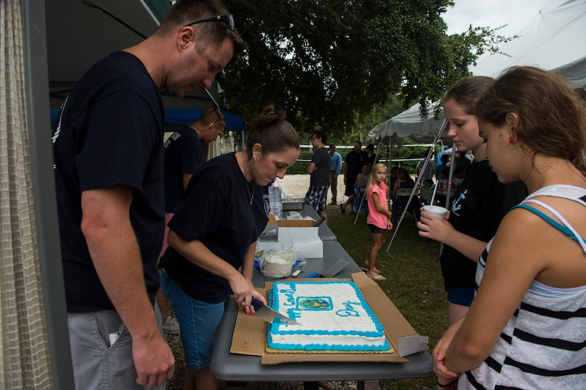 Rachel Gentry, U.S.C.G. Sector Charleston Ombudsman, cuts a birthday cake during the Coast Guard birthday celebration Aug. 4, 2014, at U.S.C.G. Sector Charleston, S.C. Members of the Coast Guard and their families celebrated the 224th birthday of the Coast Guard, the United States' oldest continuous sea-going service..  (U.S. Air Force photo/Senior Airman George Goslin)