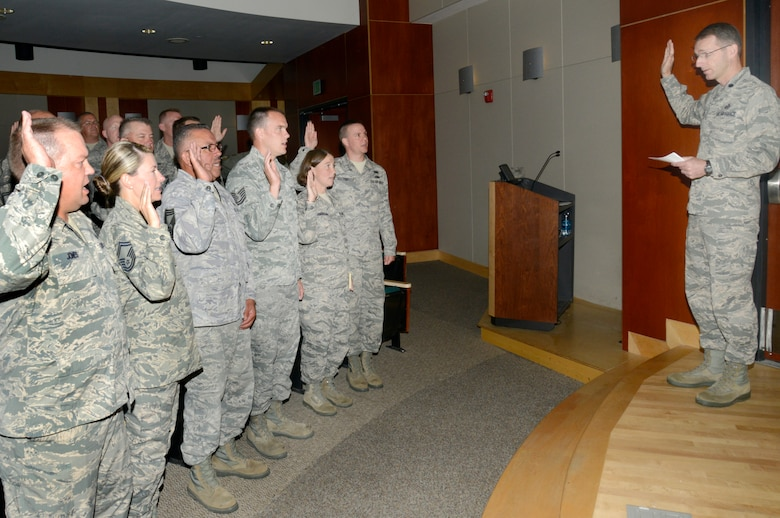 Lt. Col. Jonathan Boyd, vice wing commander of the 151st Air Refueling Wing, administers the Inspector General Oath of Office to more than 30 Airmen who will become the newest members of the Wing Inspection Team. The team is comprised of a total of 91 Airmen from across the base whose goal is to help ensure unit readiness by performing inspections and evaluations for the new Commander's Inspection Program. The Utah Air National Guard is expected to undergo a Unit Effectiveness Inspection under the program in July 2015. (Utah Air National Guard photo by Staff Sgt. Joe Davis/RELEASED)