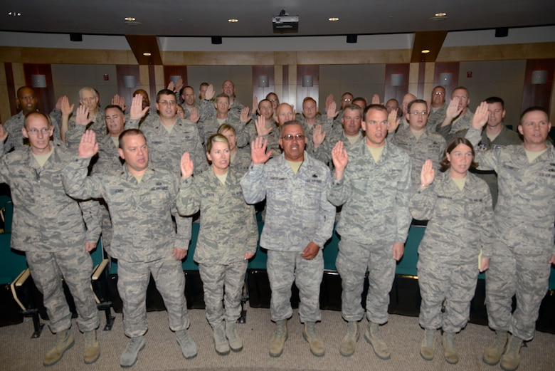 More than thirty Airmen from the Utah Air National Guard take the Inspector General Oath of Office to become the newest members of the Wing Inspection Team. The team is comprised of a total of 91 Airmen from across the base whose goal is to help ensure unit readiness by performing inspections and evaluations for the new Commander's Inspection Program. The Utah Air National Guard is expected to undergo a Unit Effectiveness Inspection under the program in July 2015. (Utah Air National Guard photo by Staff Sgt. Joe Davis/RELEASED)
