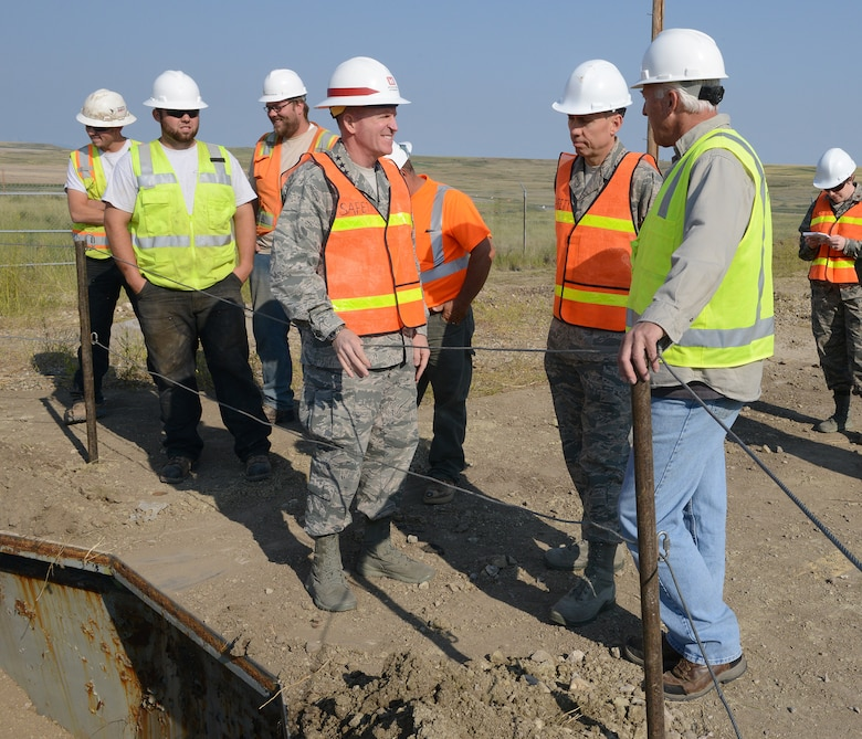 Lt. Gen. Stephen Wilson, Air Force Global Strike Command commander (center) reviews the demolition of Launch Facility T-49 with Col. Tom Wilcox, 341st Missile Wing commander, and Rick Bialczak, 341st MW treaty compliance office chief, August 5, 2014. The site is the last of 50 Minuteman III missile launch silos once operated by the 564th Missile Squadron that are being eliminated from Malmstrom Air Force Base, Mont., in compliance with the New Strategic Arms Reduction Treaty. (Air Force photo/Senior Airman Katrina Heikkinen)