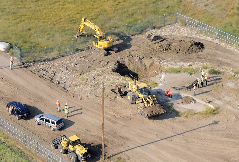 An aerial view of Launch Facility T-49 shows demolition of the launcher in progress August 5, 2014. The site is located approximately 25 miles west of Conrad, Mont., and is the final deactivated Minuteman III missile launch silo of 50 once operated by the 564th Missile Squadron being eliminated from Malmstrom Air Force Base in accordance with the New Strategic Arms Reduction Treaty. (Air Force photo/Senior Airman Katrina Heikkinen)