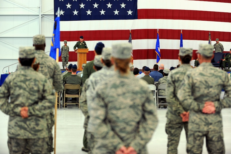 Col. Ross Anderson, 926th Group commander, speaks during the 926th GP's change of command ceremony at Nellis Air Force Base, Nev., July 31, 2014. Through total force integration, the 926th GP provides combat-ready reservists to the U.S. Air Force Warfare Center as sustained expertise integrated at the operational and tactical levels of warfare, and continuously conduct combat operations, operational test and evaluation, tactics development and advanced training to forge the tools required to fly, fight and win. (U.S. Air Force photo by Airman 1st Class Mikaley Towle)