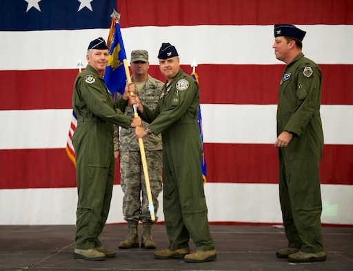 Maj. Gen. William Binger, 10th Air Force commander, (left) passes the 926th Group guidon to the new 926th GP commander, Col. Ross Anderson, during the change of command ceremony at Nellis Air Force Base, Nev., July 31, 2014. The 926th Group is comprised of 10 squadrons and one detachment located across the nation, is an Air Force Reserve unit assigned to the 10th AF. (U.S. Air Force photo by Airman 1st Class Mikaley Towle)