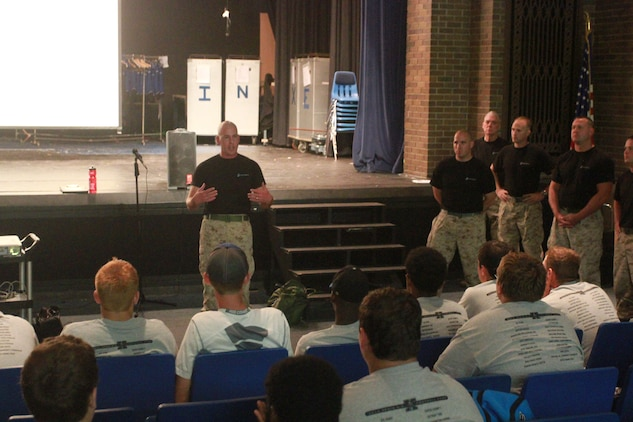 U.S. Marine Corps Gunnery Sgt. Christopher Balderston, the staff noncommissioned officer in charge of Recruiting Sub-Station Xenia, speaks to members of the Xenia High School football team during a leadership seminar conducted at the high school in Xenia, Ohio, July 31, 2014. The seminar was conducted by Marines from Recruiting Station Charleston with the purpose of developing the leadership abilities of the football team by teaching Marine Corps values. (U.S. Marine Corps photo by Sgt. Tyler Hlavac/Released)